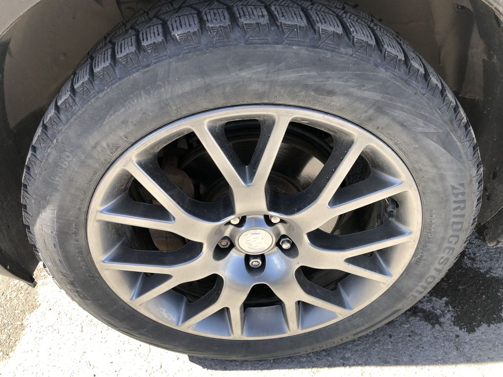White[Summit White] 2017 Buick Encore CX Left Front Rim and Tire Photo in Canmore AB