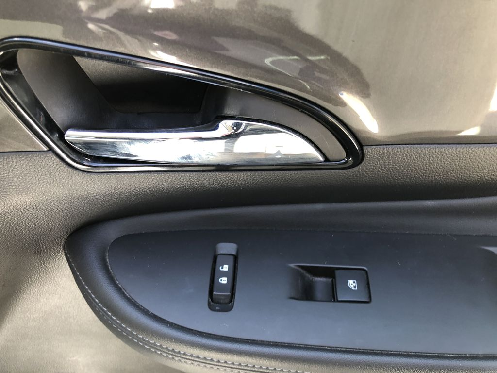 White[Summit White] 2017 Buick Encore CX Passenger Front Door Controls Photo in Canmore AB