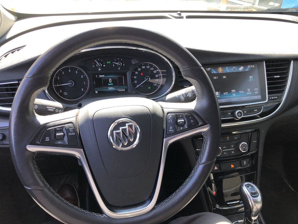 White[Summit White] 2017 Buick Encore CX Steering Wheel and Dash Photo in Canmore AB