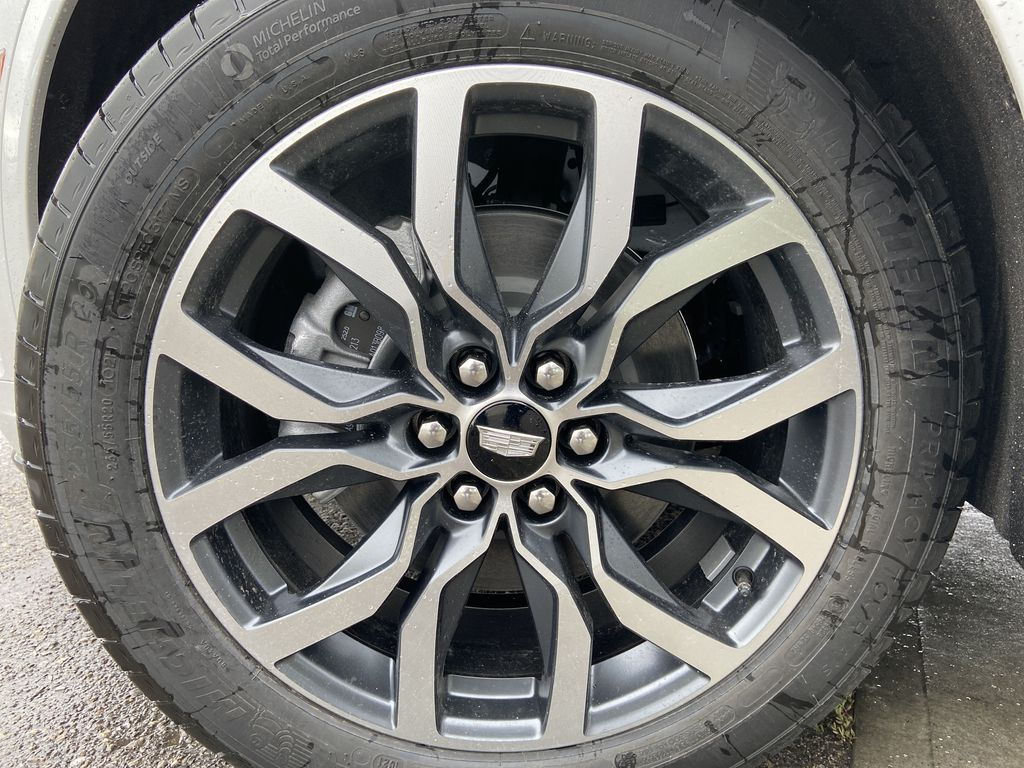 White[Crystal White Tricoat] 2021 Cadillac XT6 Sport Left Front Rim and Tire Photo in Calgary AB