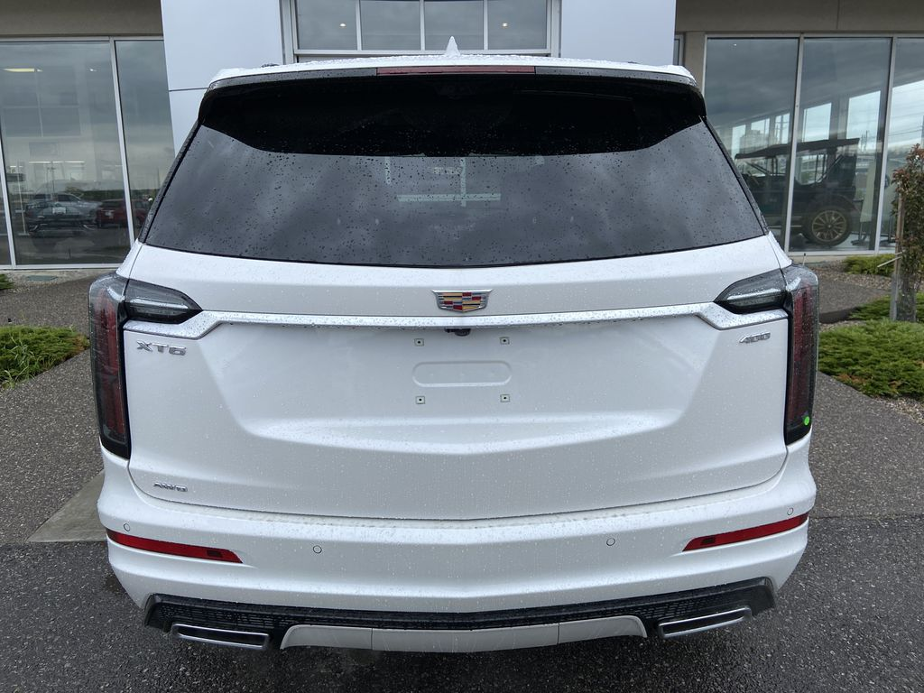 White[Crystal White Tricoat] 2021 Cadillac XT6 Sport Rear of Vehicle Photo in Calgary AB