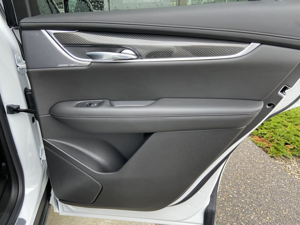 White[Crystal White Tricoat] 2021 Cadillac XT6 Sport Right Rear Interior Door Panel Photo in Calgary AB