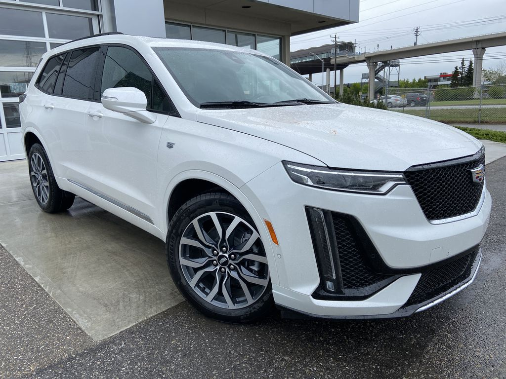 White[Crystal White Tricoat] 2021 Cadillac XT6 Sport Right Front Corner Photo in Calgary AB