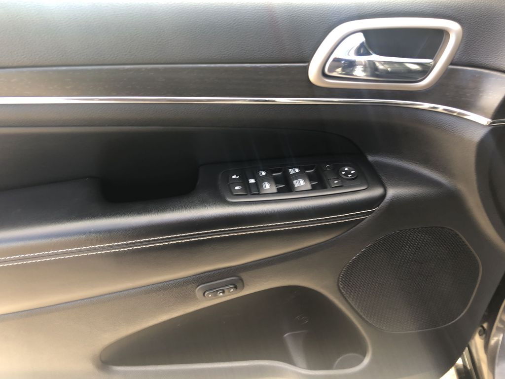 Gray[Granite Crystal Metallic] 2016 Jeep Grand Cherokee Limited Left Front Interior Door Panel Photo in Canmore AB