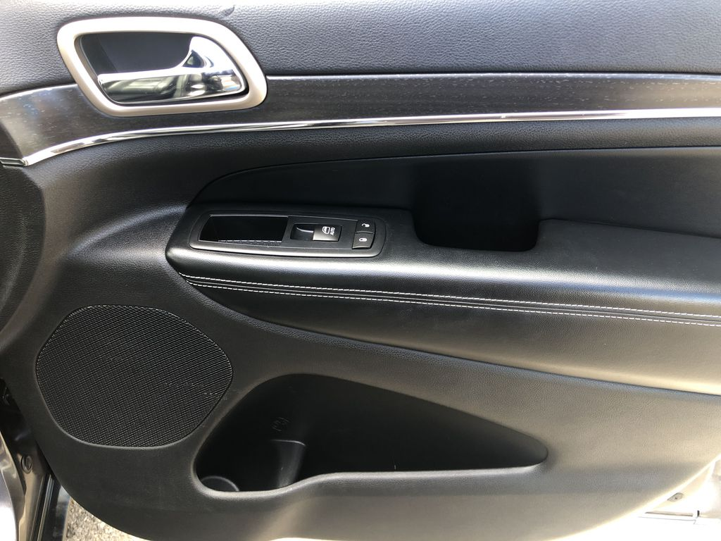 Gray[Granite Crystal Metallic] 2016 Jeep Grand Cherokee Limited Right Front Interior Door Panel Photo in Canmore AB