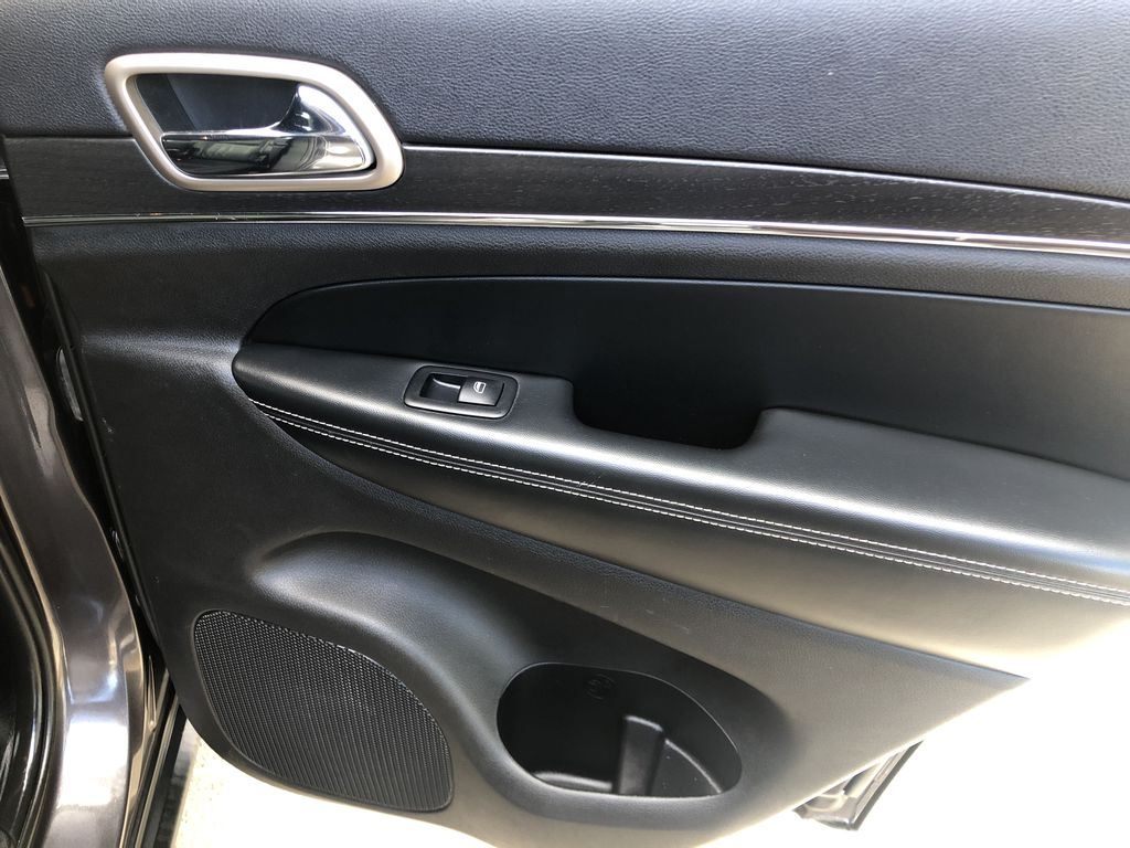 Gray[Granite Crystal Metallic] 2016 Jeep Grand Cherokee Limited Right Rear Interior Door Panel Photo in Canmore AB