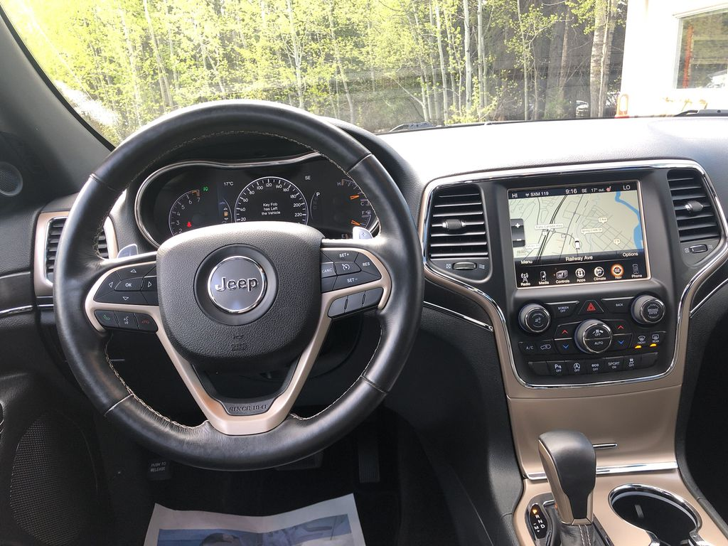Gray[Granite Crystal Metallic] 2016 Jeep Grand Cherokee Limited Strng Wheel/Dash Photo: Frm Rear in Canmore AB