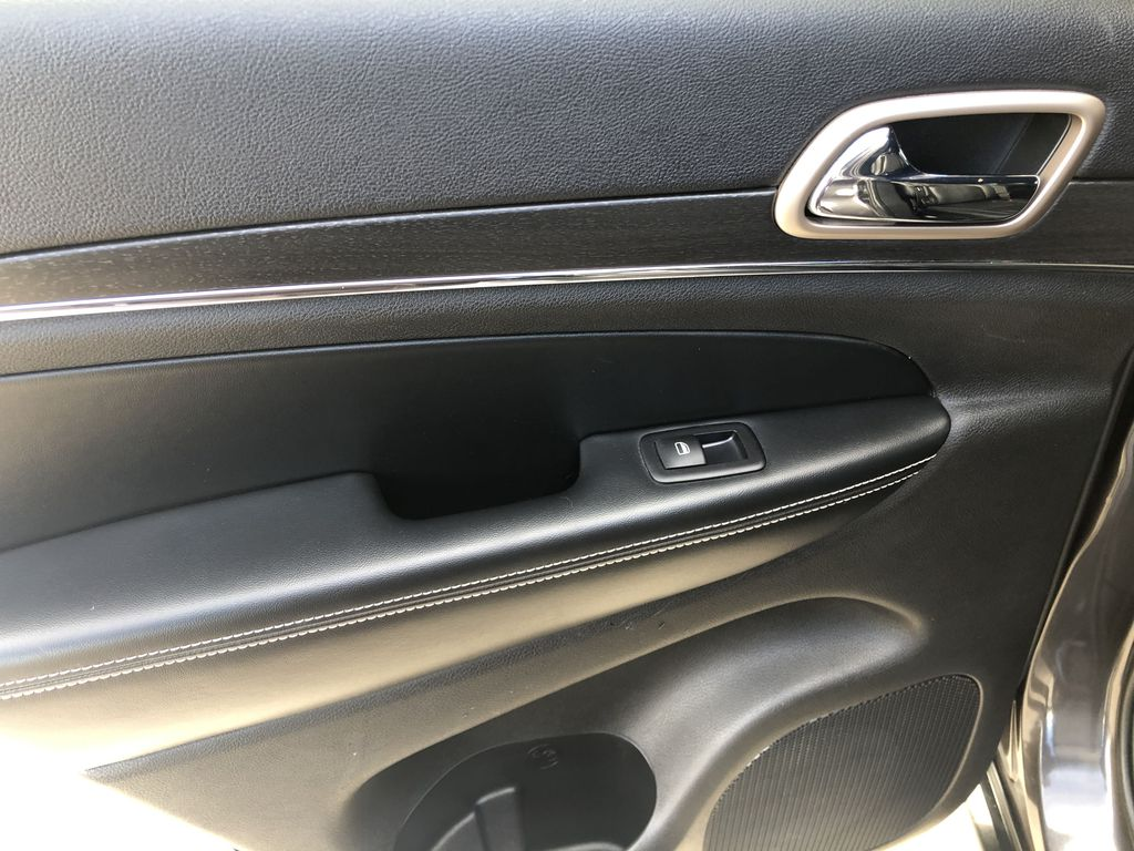 Gray[Granite Crystal Metallic] 2016 Jeep Grand Cherokee Limited Left Rear Interior Door Panel Photo in Canmore AB