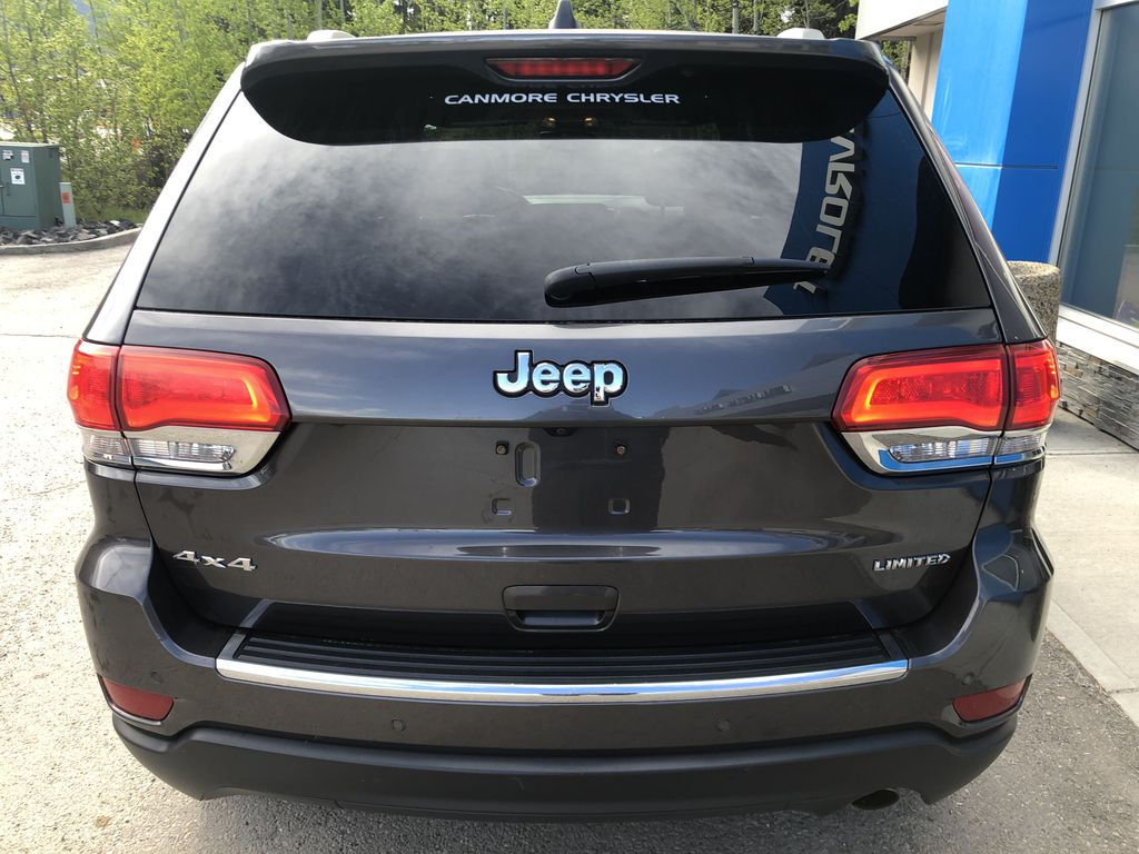 Gray[Granite Crystal Metallic] 2016 Jeep Grand Cherokee Limited Rear of Vehicle Photo in Canmore AB