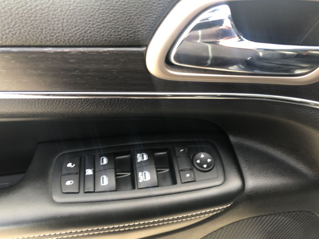 Gray[Granite Crystal Metallic] 2016 Jeep Grand Cherokee Limited  Driver's Side Door Controls Photo in Canmore AB