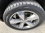 Gray[Granite Crystal Metallic] 2016 Jeep Grand Cherokee Limited Left Front Rim and Tire Photo in Canmore AB