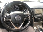 Gray[Granite Crystal Metallic] 2016 Jeep Grand Cherokee Limited Steering Wheel and Dash Photo in Canmore AB