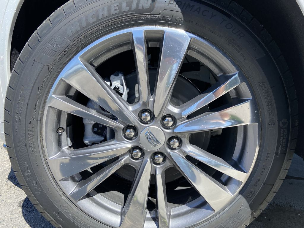 White[Crystal White Tricoat] 2021 Cadillac XT6 Premium Luxury Left Front Rim and Tire Photo in Calgary AB