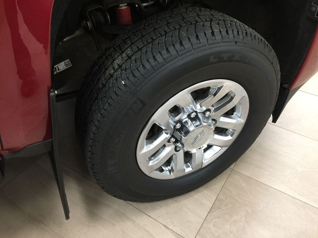 Red[Cajun Red Tintcoat] 2019 Chevrolet Silverado 2500HD DIESEL LTZ CREW CAB 4X4 Right Front Rim and Tire Photo in Sherwood Park AB