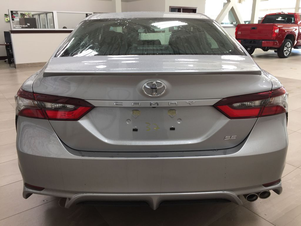 Silver[Celestial Silver Metallic] 2021 Toyota Camry SE FWD Rear of Vehicle Photo in Sherwood Park AB