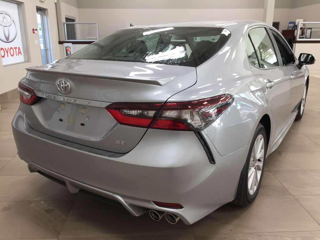 Silver[Celestial Silver Metallic] 2021 Toyota Camry SE FWD Right Rear Corner Photo in Sherwood Park AB