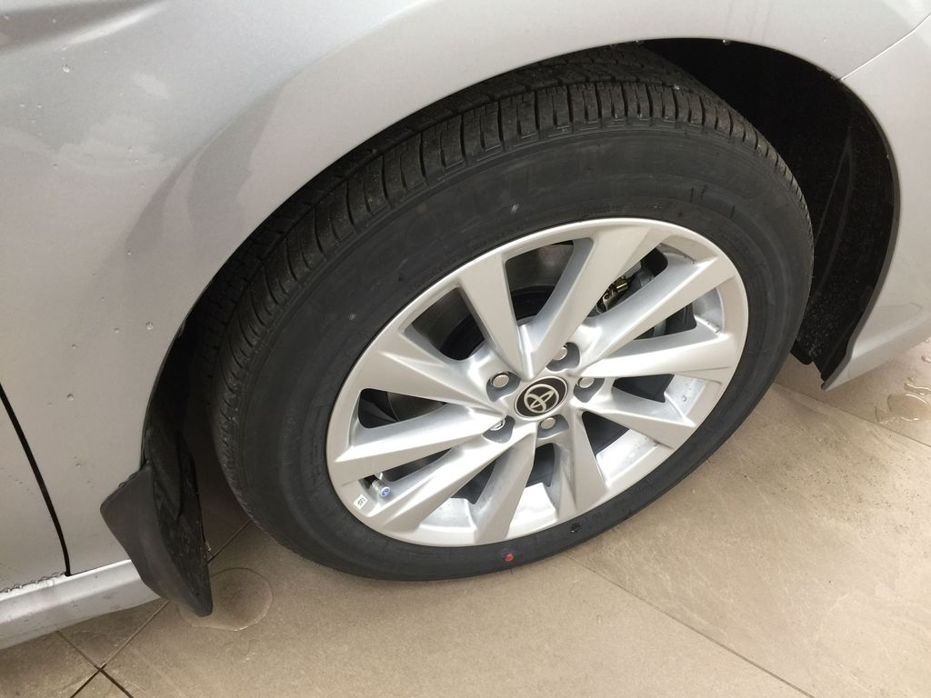Silver[Celestial Silver Metallic] 2021 Toyota Camry SE FWD Right Front Rim and Tire Photo in Sherwood Park AB