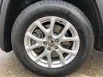 Black[Brilliant Black Crystal Pearl] 2016 Jeep Cherokee Left Front Rim and Tire Photo in Edmonton AB