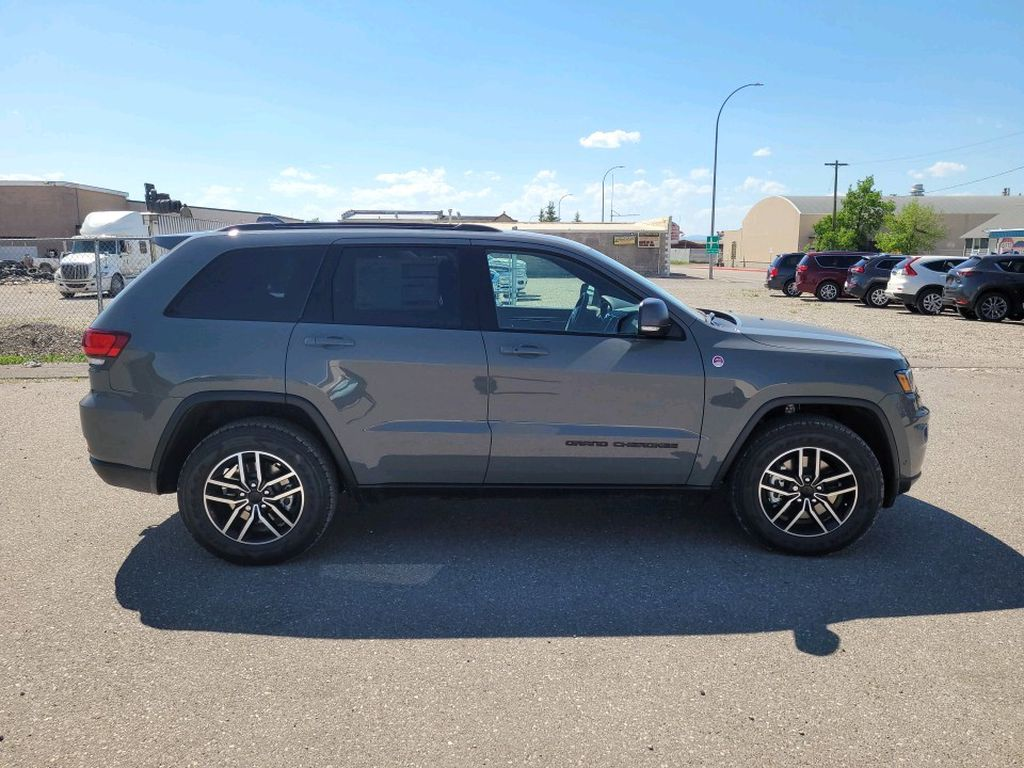 Grey 2021 Jeep Grand Cherokee Left Front Interior Photo in Fort Macleod AB