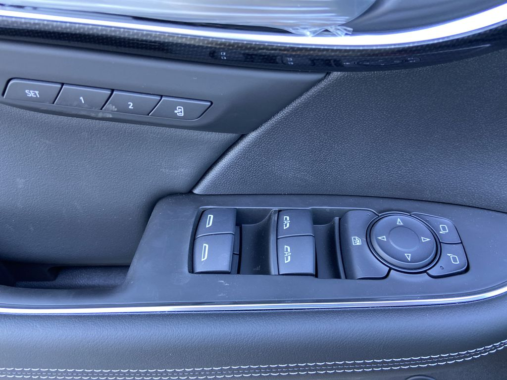 Red[Cinnabar Metallic] 2021 Buick Envision Essence  Driver's Side Door Controls Photo in Calgary AB
