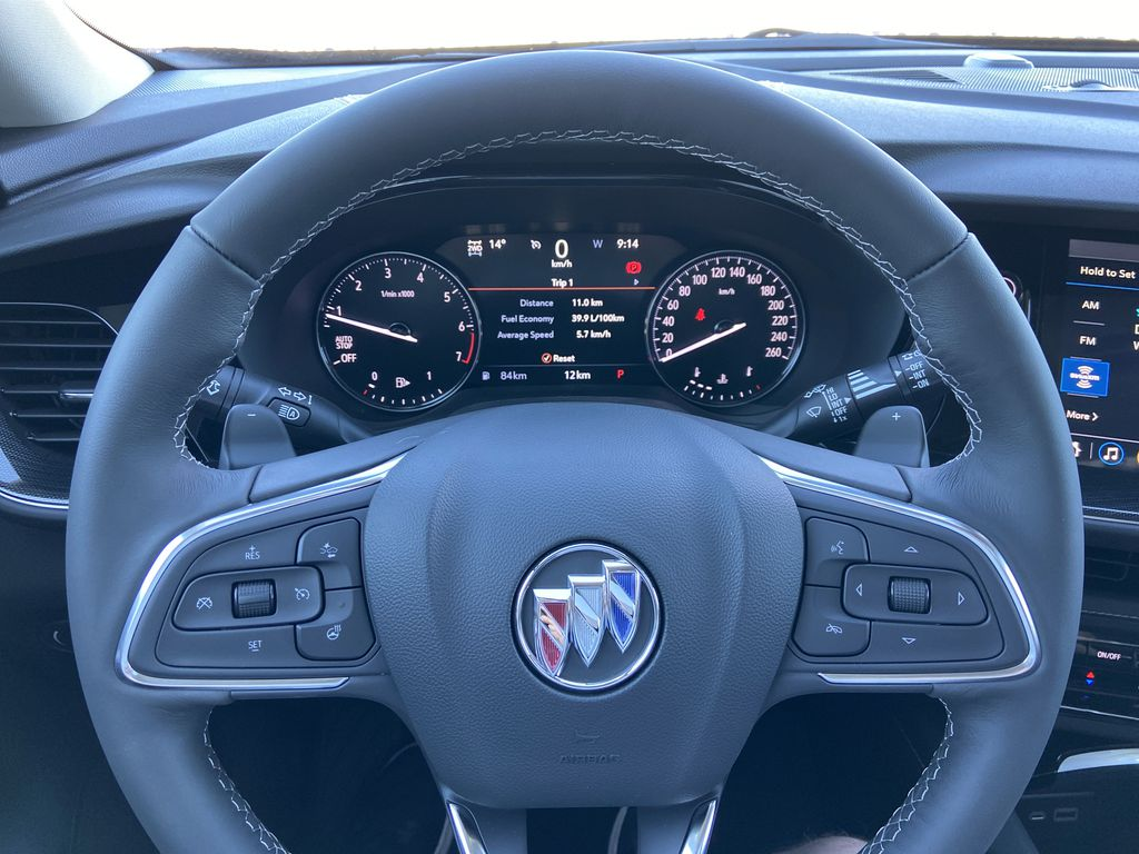 Red[Cinnabar Metallic] 2021 Buick Envision Essence Steering Wheel and Dash Photo in Calgary AB