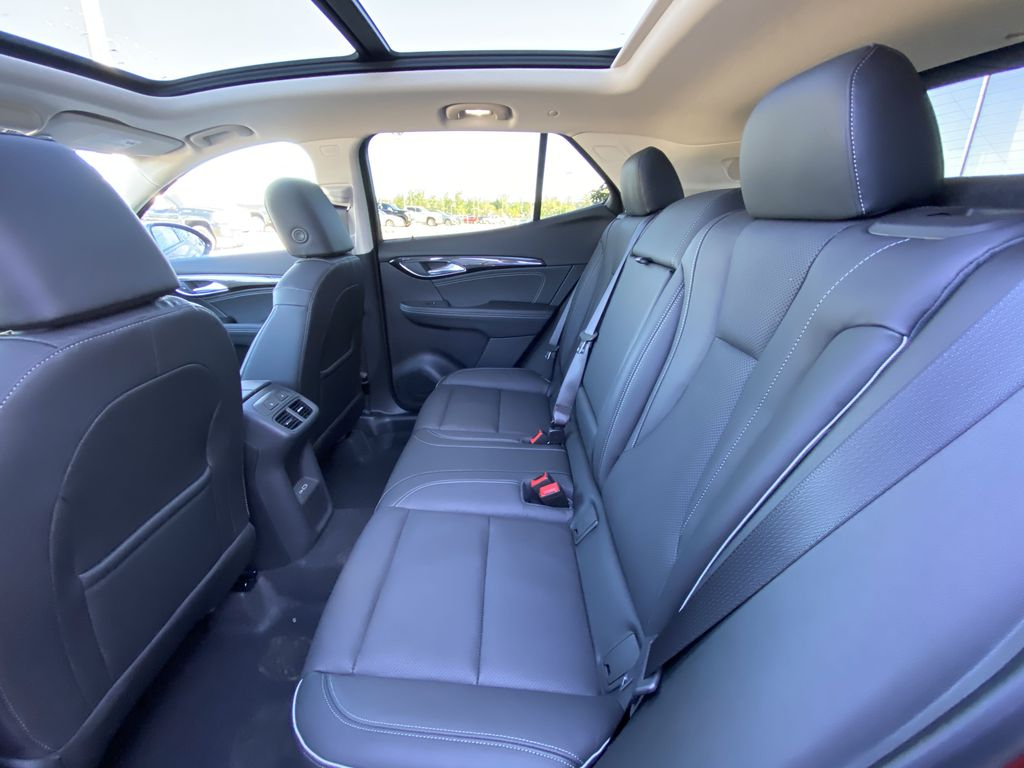 Red[Cinnabar Metallic] 2021 Buick Envision Essence Left Side Rear Seat  Photo in Calgary AB