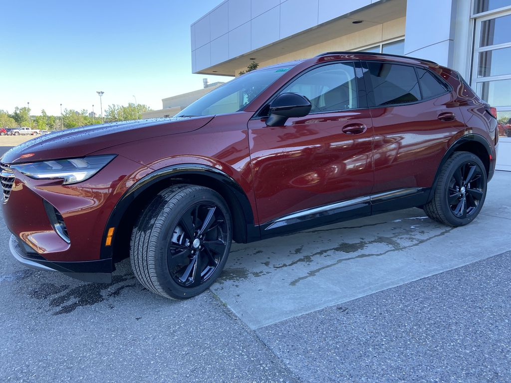 Red[Cinnabar Metallic] 2021 Buick Envision Essence Left Front Corner Photo in Calgary AB