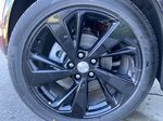 Red[Cinnabar Metallic] 2021 Buick Envision Essence Left Front Rim and Tire Photo in Calgary AB