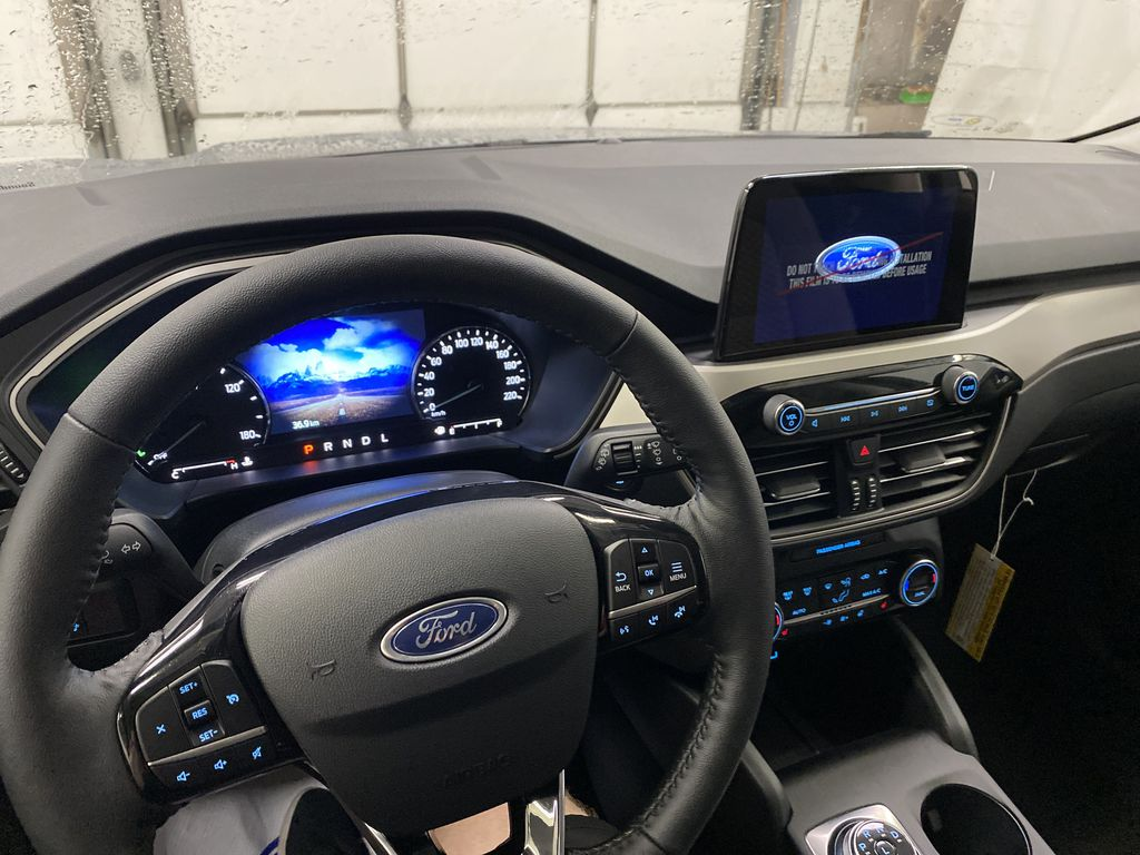 Silver[Iconic Silver Metallic] 2021 Ford Escape Steering Wheel and Dash Photo in Dartmouth NS
