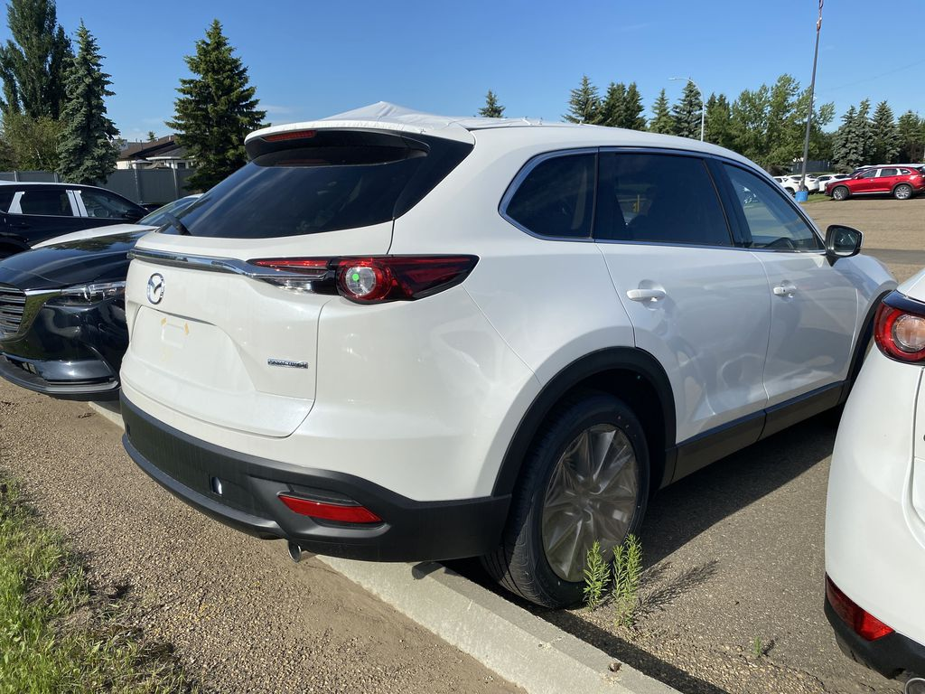 SNOW FLAKE WHITE PEARL(25D) 2021 Mazda CX-9 GS-L Captain Chairs  Driver's Side Door Controls Photo in Edmonton AB