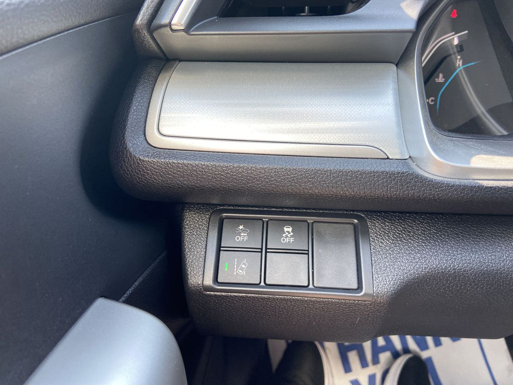 Black[Crystal Black Pearl] 2018 Honda Civic Coupe Touring Center Console Photo in Calgary AB