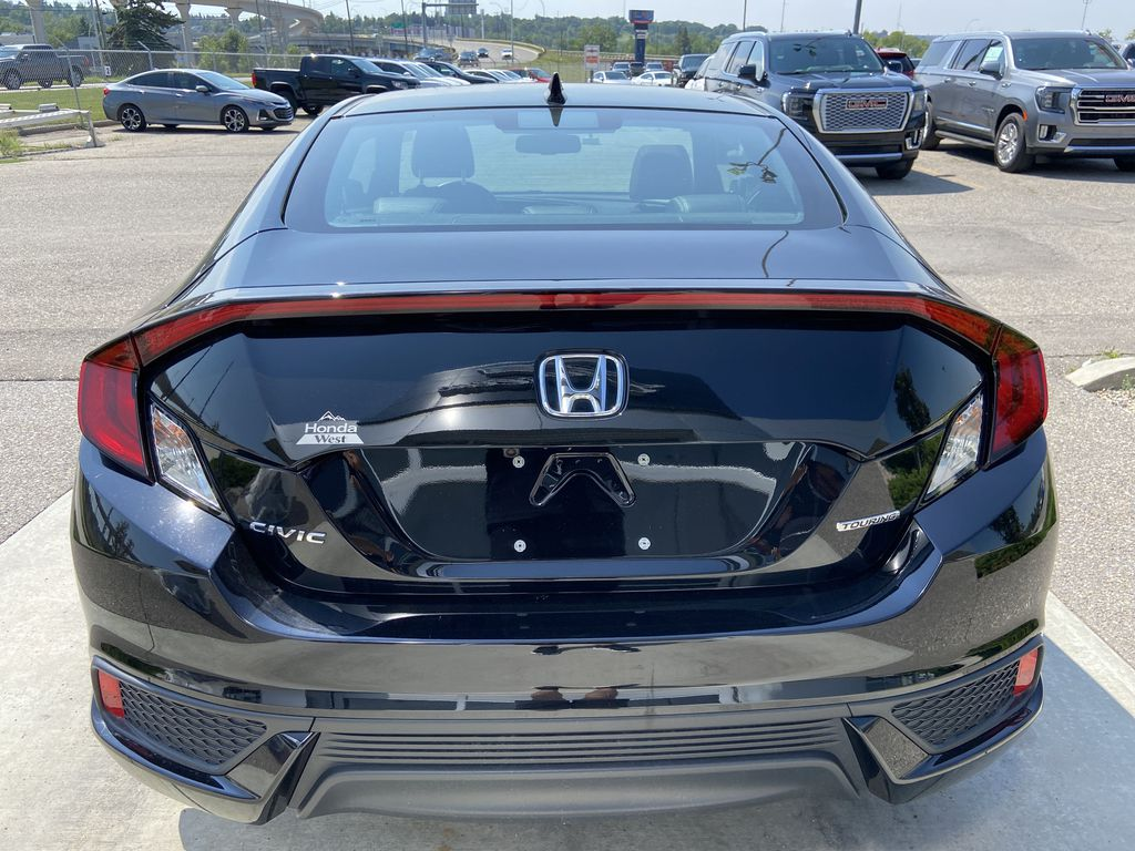 Black[Crystal Black Pearl] 2018 Honda Civic Coupe Touring Rear of Vehicle Photo in Calgary AB
