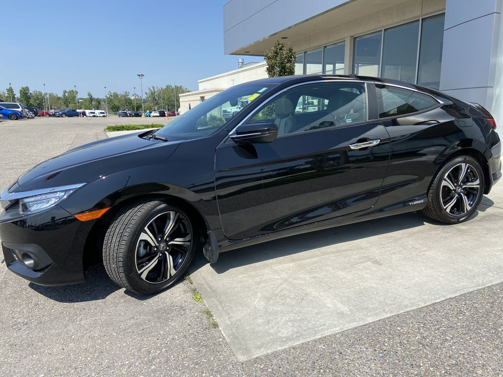 Black[Crystal Black Pearl] 2018 Honda Civic Coupe Touring Left Front Corner Photo in Calgary AB