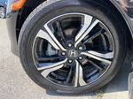 Black[Crystal Black Pearl] 2018 Honda Civic Coupe Touring Left Front Rim and Tire Photo in Calgary AB