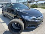 Black[Crystal Black Pearl] 2018 Honda Civic Coupe Touring Primary Photo in Calgary AB