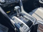 Black[Crystal Black Pearl] 2018 Honda Civic Coupe Touring Central Dash Options Photo in Calgary AB
