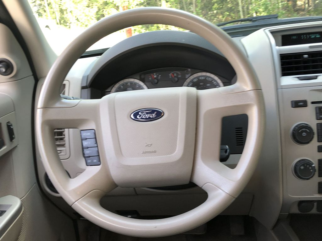 Silver[Silver Metallic] 2008 Ford Escape XLT Strng Wheel: Frm Rear in Canmore AB