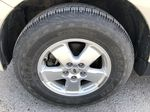 Silver[Silver Metallic] 2008 Ford Escape XLT Left Front Rim and Tire Photo in Canmore AB