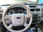 Silver[Silver Metallic] 2008 Ford Escape XLT Steering Wheel and Dash Photo in Canmore AB