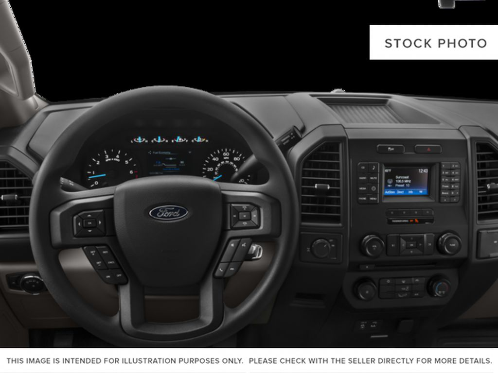 White[Oxford White] 2017 Ford F-150 Steering Wheel and Dash Photo in Fort Macleod AB