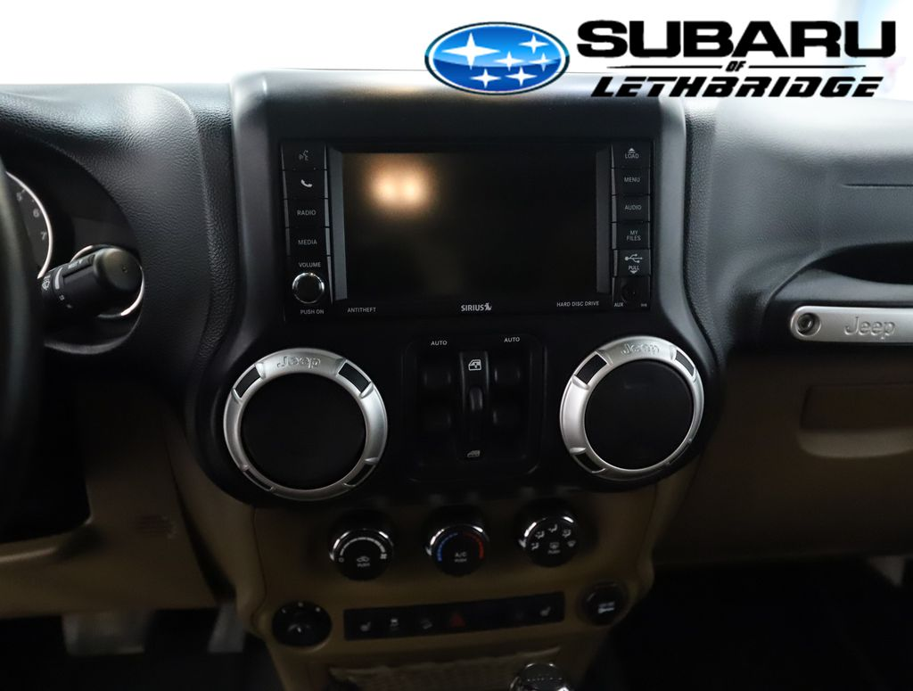 White 2013 Jeep Wrangler Unlimited Steering Wheel and Dash Photo in Lethbridge AB