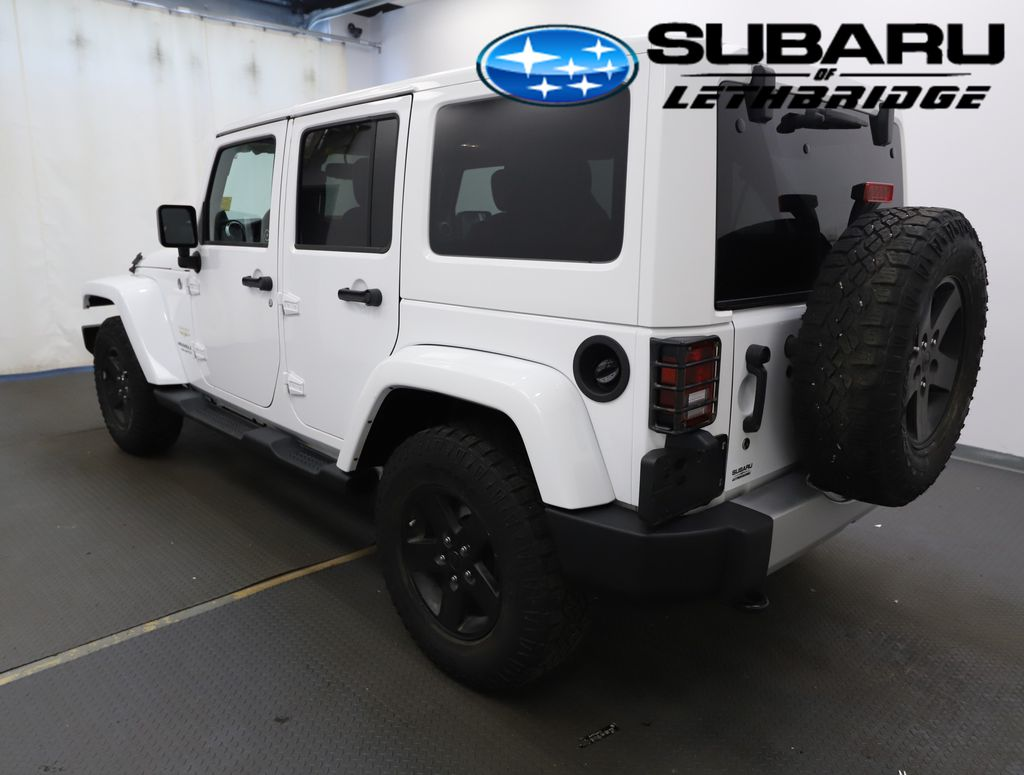 White 2013 Jeep Wrangler Unlimited Left Front Head Light / Bumper and Grill in Lethbridge AB