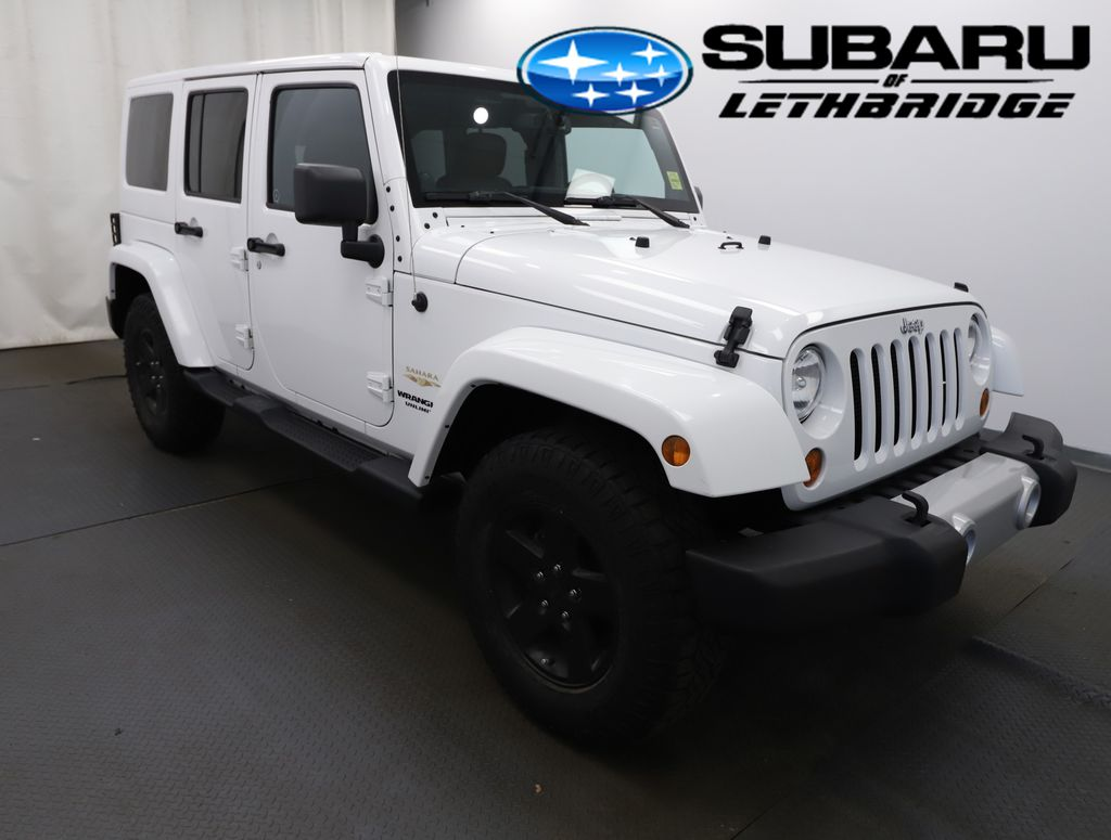 White 2013 Jeep Wrangler Unlimited Left Front Rim and Tire Photo in Lethbridge AB
