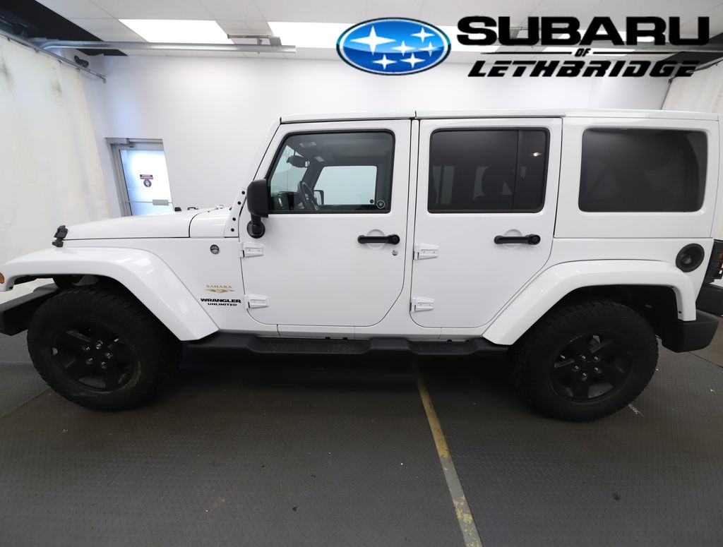 White 2013 Jeep Wrangler Unlimited Front Vehicle Photo in Lethbridge AB