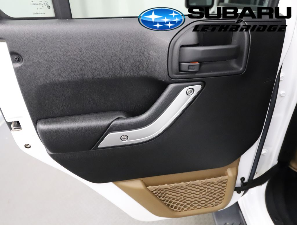White 2013 Jeep Wrangler Unlimited Central Dash Options Photo in Lethbridge AB