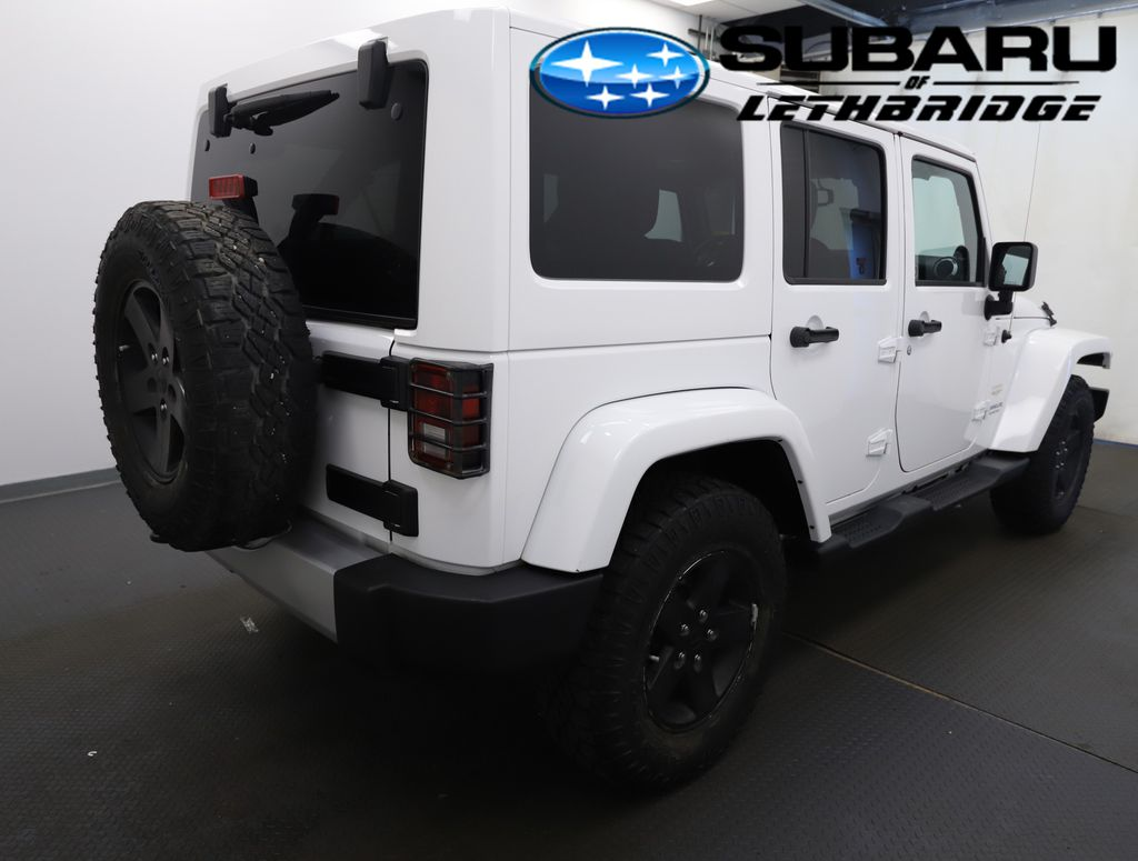 White 2013 Jeep Wrangler Unlimited Driver's Side Door Controls Photo in Lethbridge AB