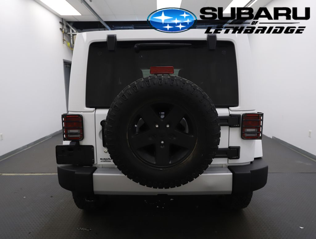 White 2013 Jeep Wrangler Unlimited Left Front Interior Photo in Lethbridge AB