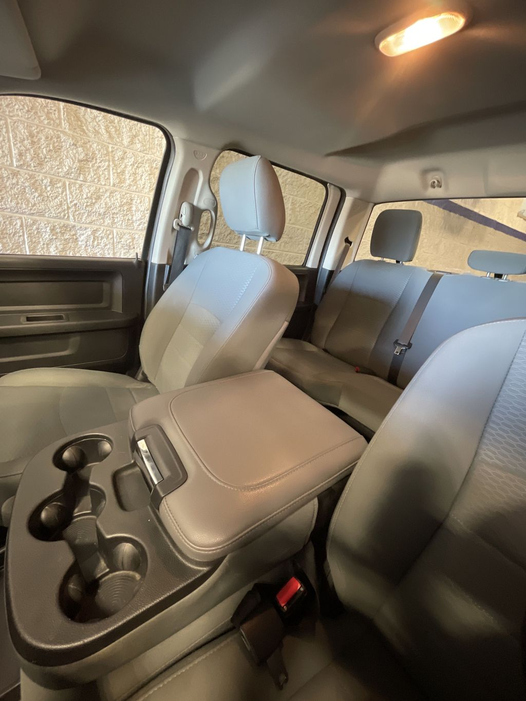 Red[Agriculture Red] 2017 Ram 1500 Steering Wheel and Dash Photo in Belleville ON