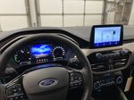 Blue[Antimatter Blue Metallic] 2021 Ford Escape Steering Wheel and Dash Photo in Dartmouth NS
