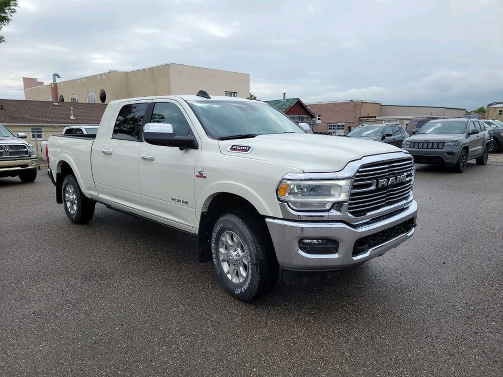 White 2021 Ram 2500 Left Front Rim and Tire Photo in Fort Macleod AB